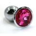 Металлическая пробка с ярко-розовым кристаллом
